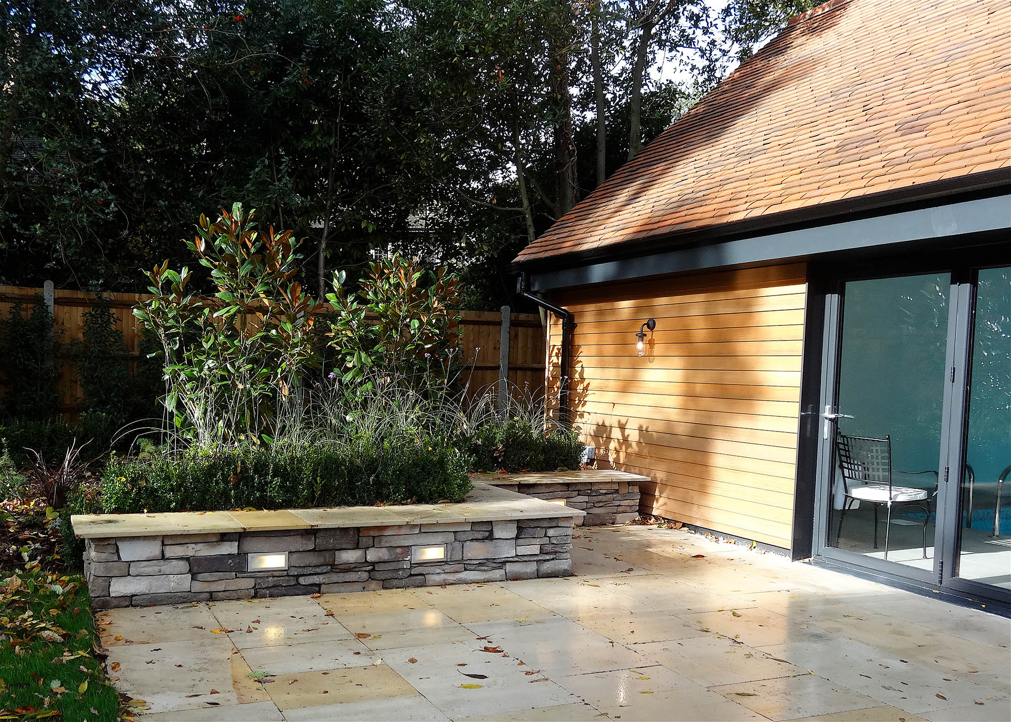 Exterior and entrance to timber barn style pool house for Kingston home.