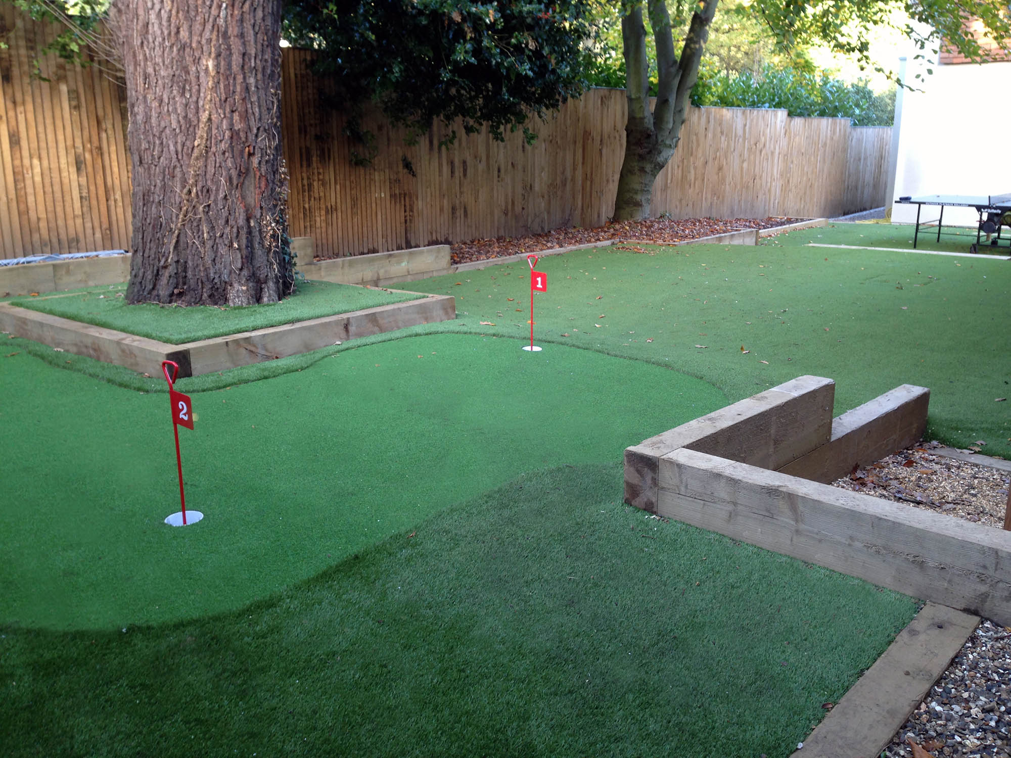 Mini golf and outdoor ping pong leisure area for pool house project in Kingston