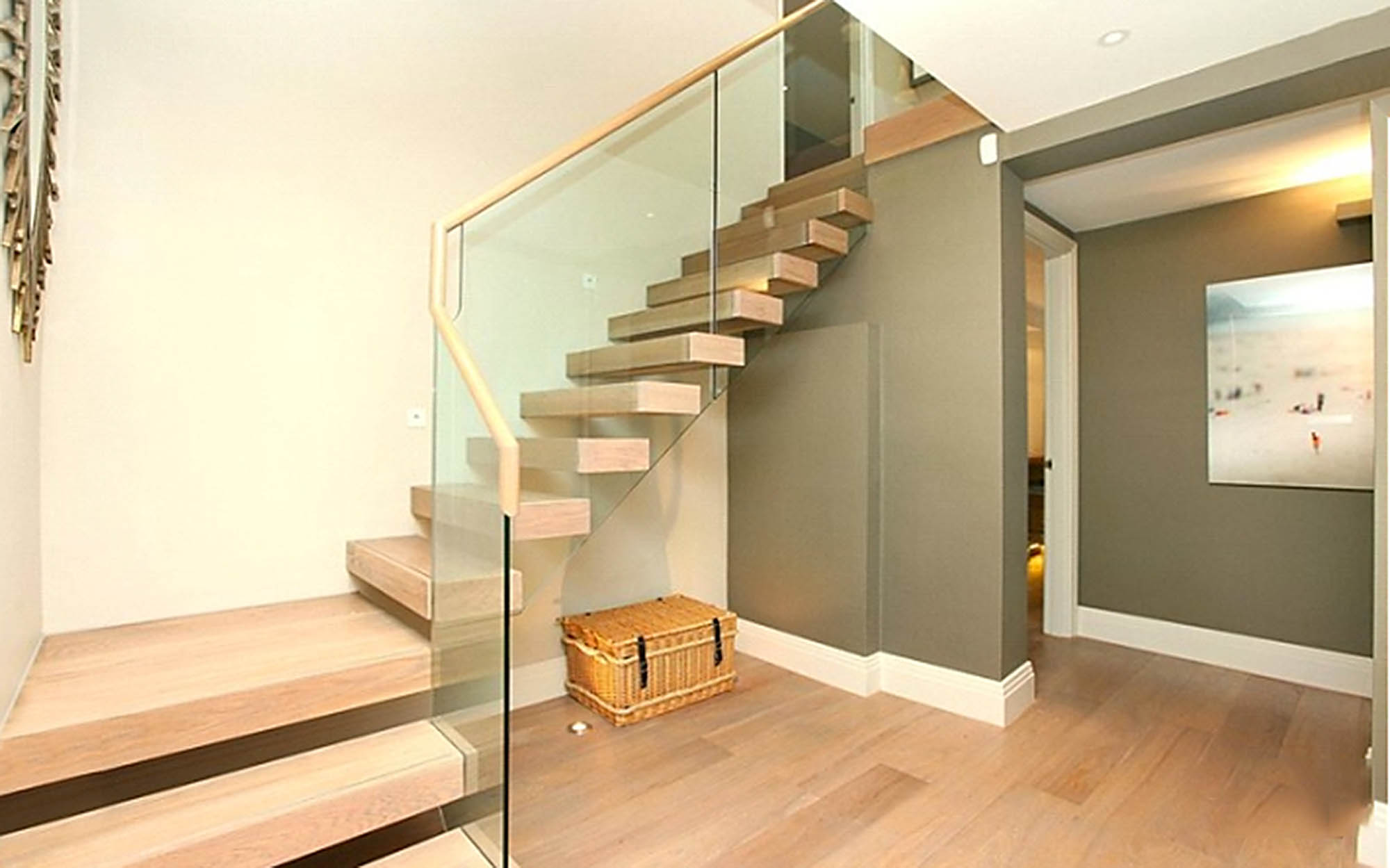 Feature cantilever staircase with glass balustrade for Putney house renovation project