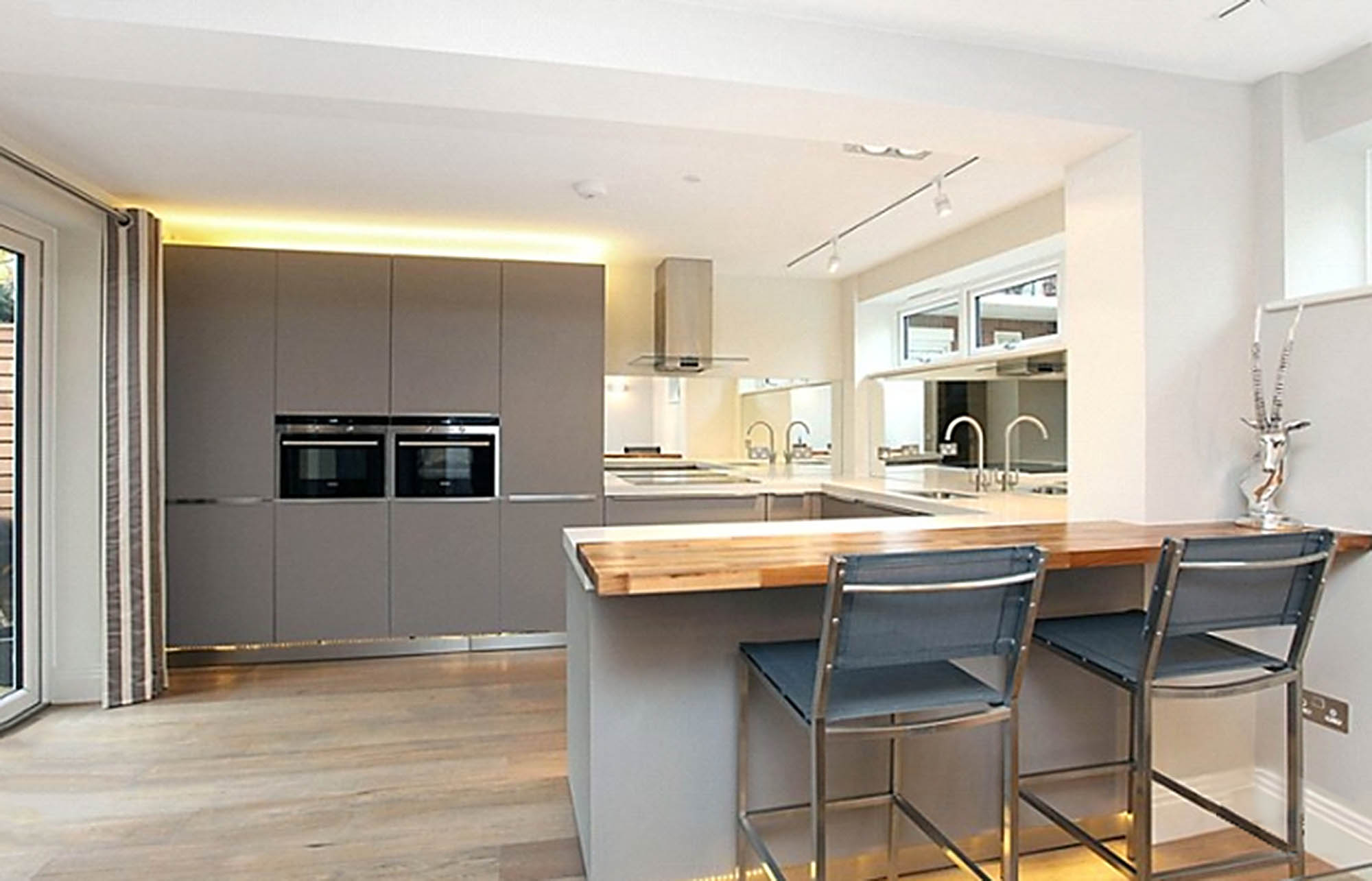 Modern family kitchen with breakfast bar for Putney house refurbishment