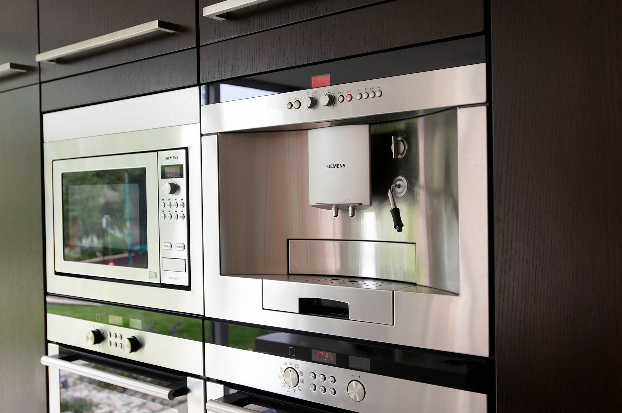 High-spec kitchen appliances for modern Kitchen renovation - wall mounted coffee maker, microwave and double ovens