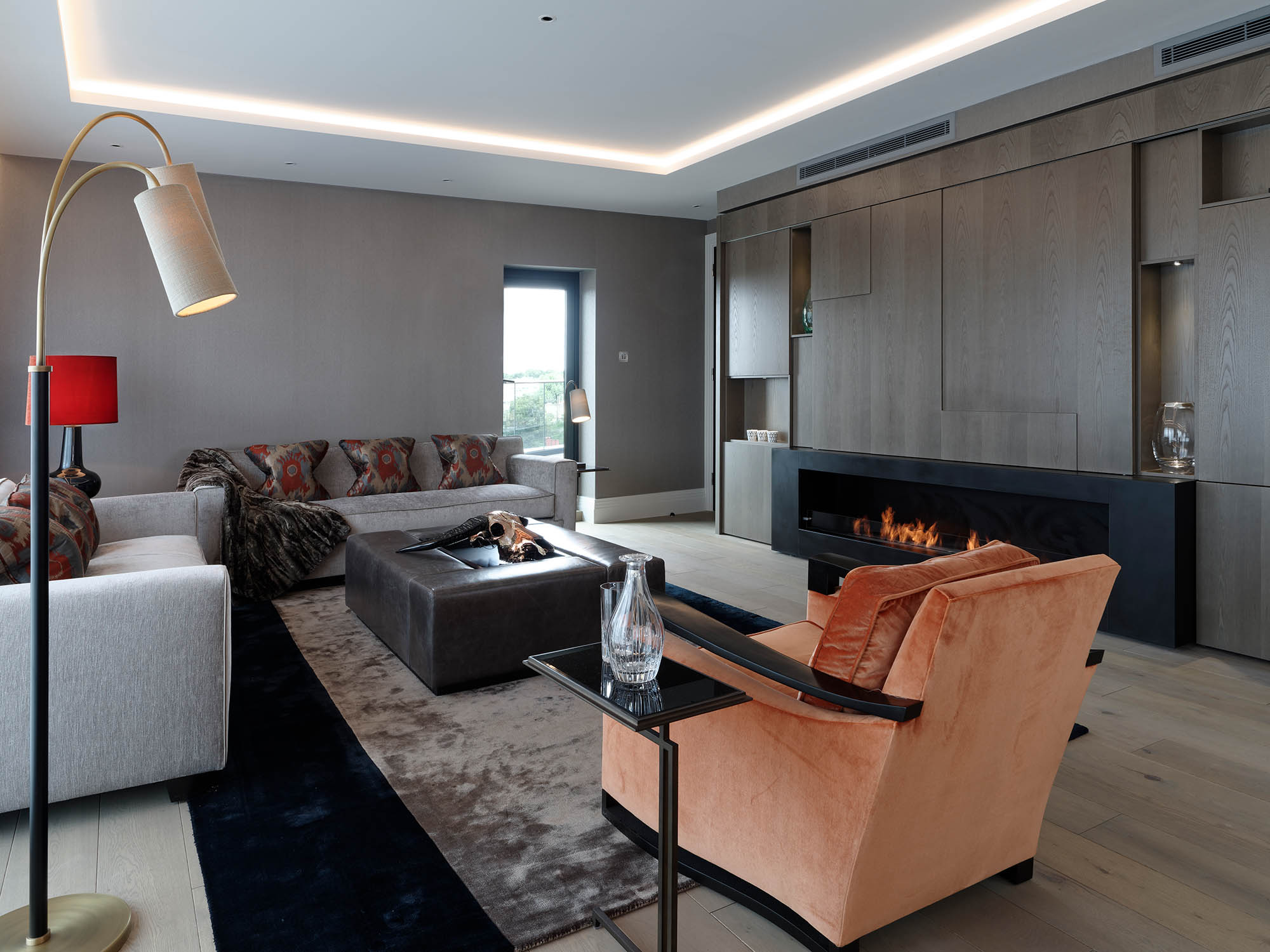 Completed lounge / sitting room for Chelsea Luxury Apartment with media wall with feature fireplace and media wall/display cabinet