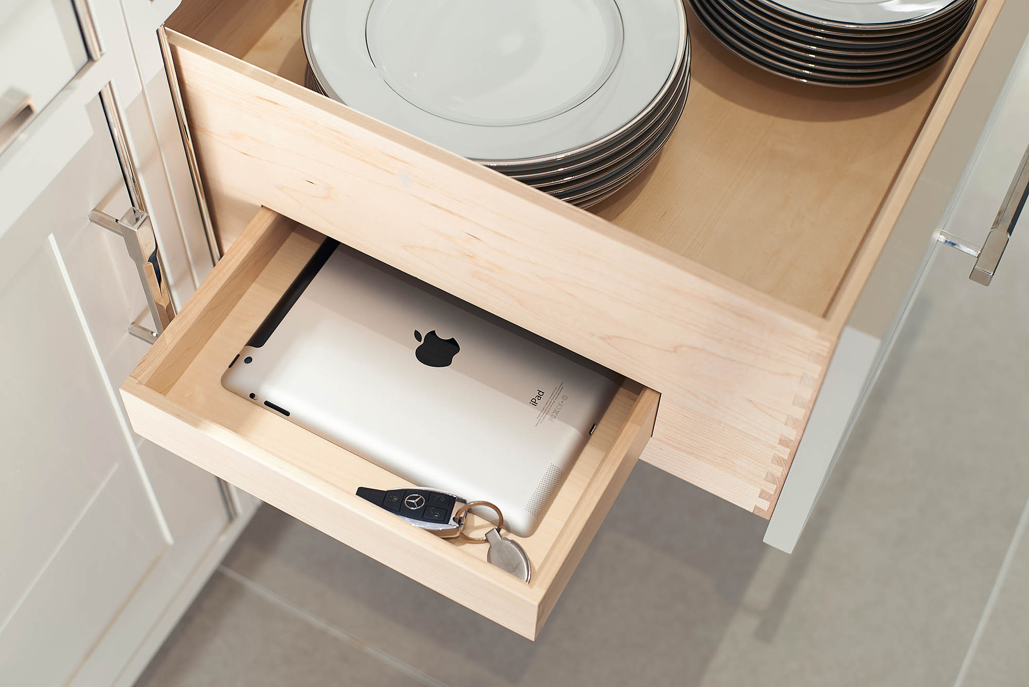 Secret drawer feature with iPad and Keys inside deep plate drawer for Coombe Estate Kitchen