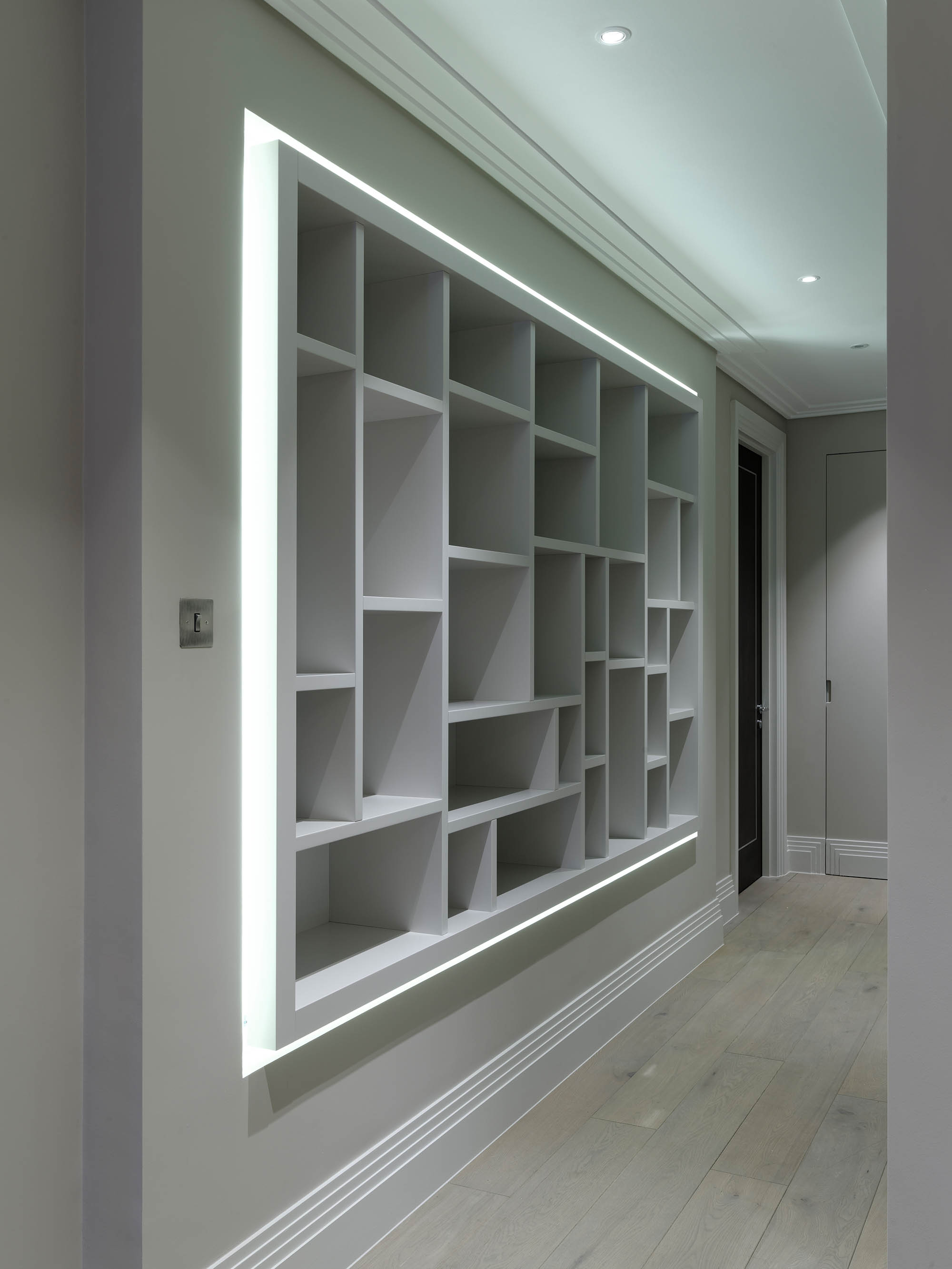 Built in display cabinet wall for luxury penthouse apartment in Chelsea