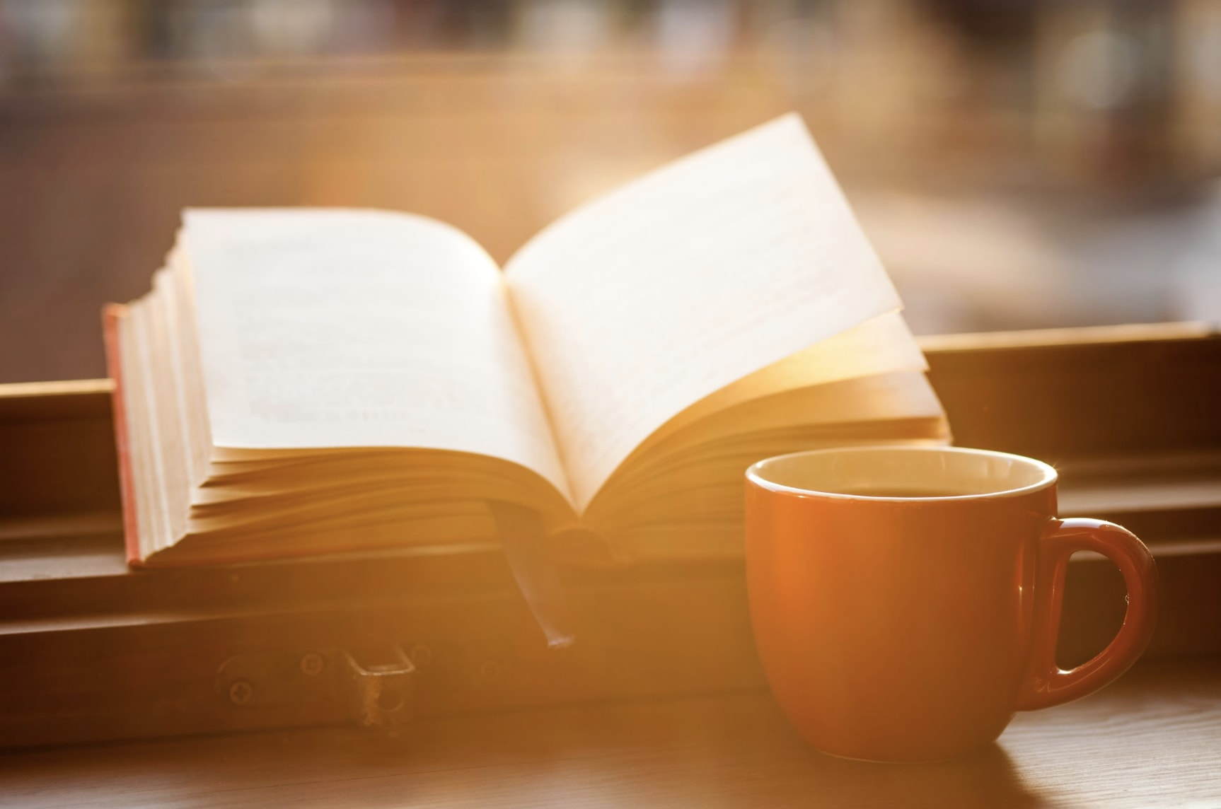 A cup of coffee and a book