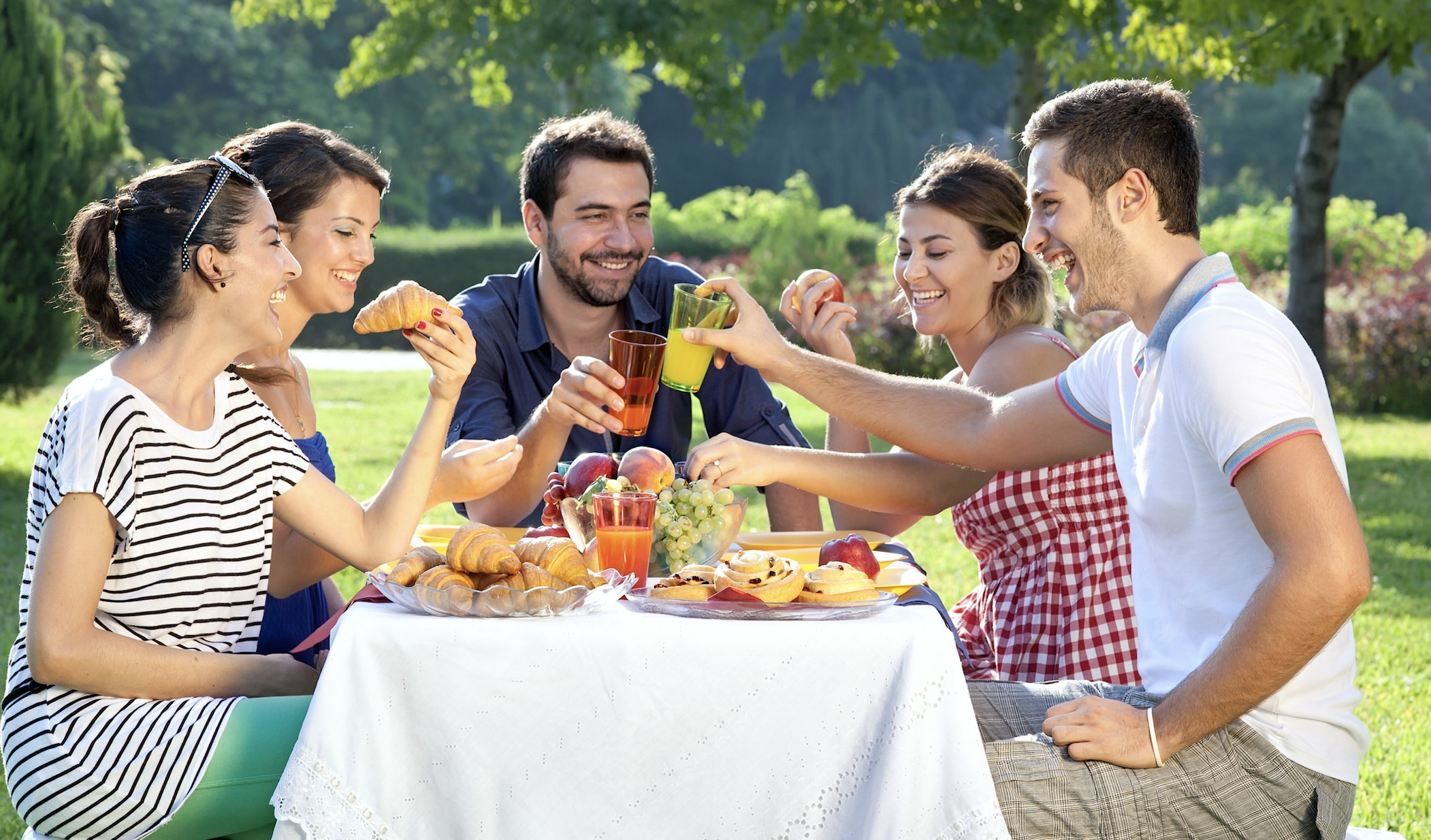 Happy people eat a vegetarian and vegan picnic