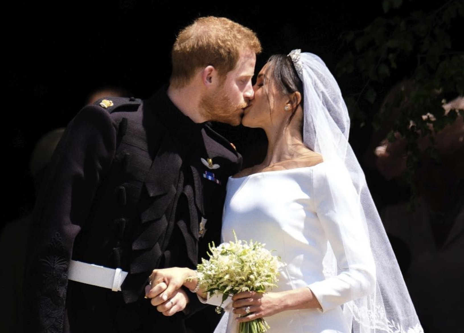 Prince Harry kisses wife Meghan Markle on their wedding day