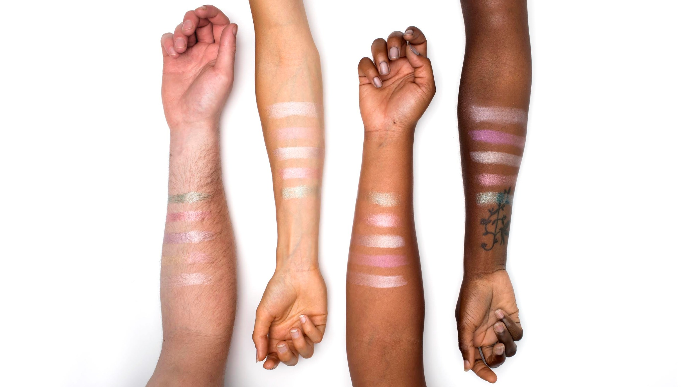Make-up swatches on different coloured arms