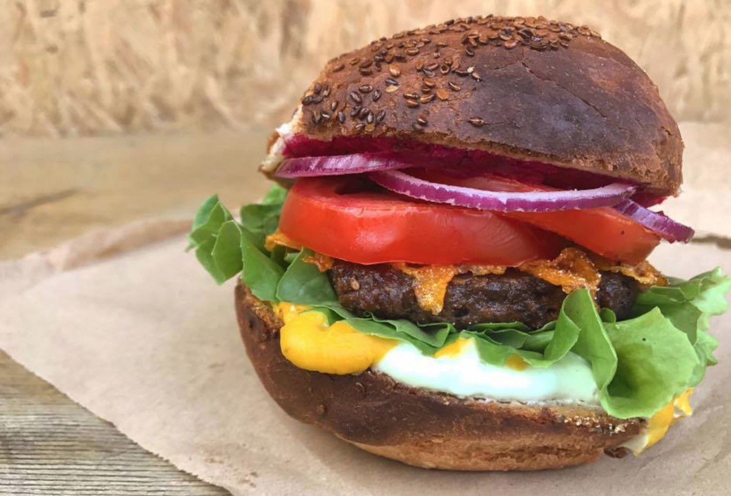 Vegan Burger with Lettuce, Onion, and Tomato