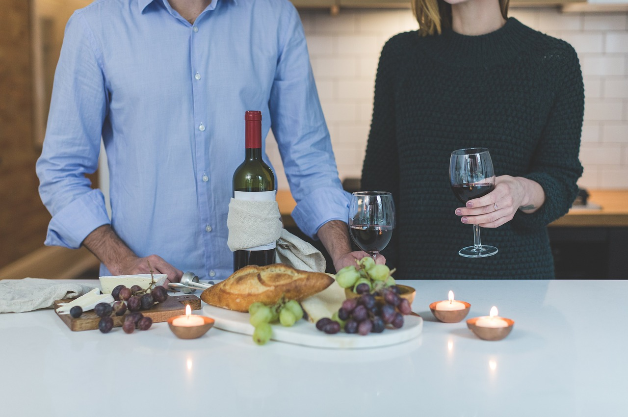 A man and woman with wine and cheese