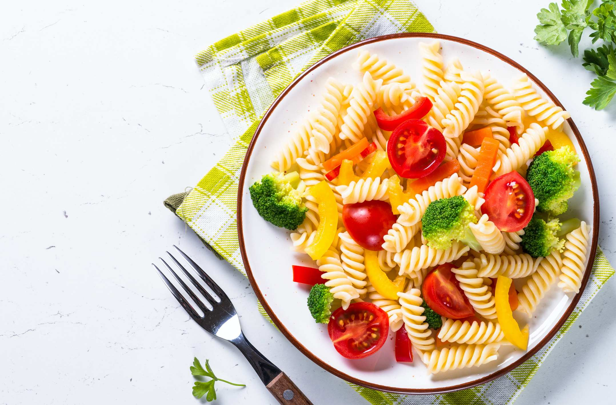 A plate of vegetable pasta