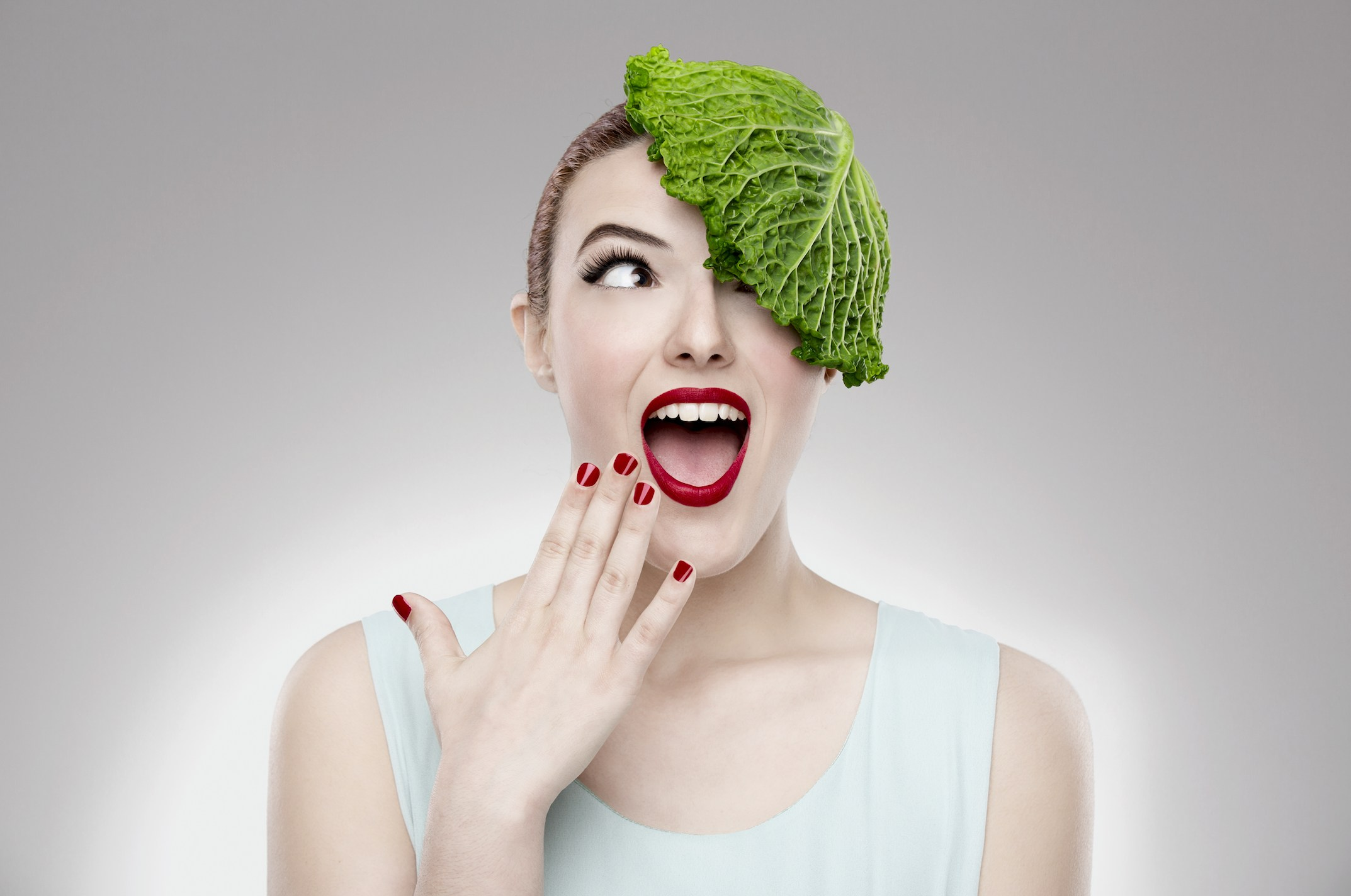 A woman with a piece of cabbage on her head