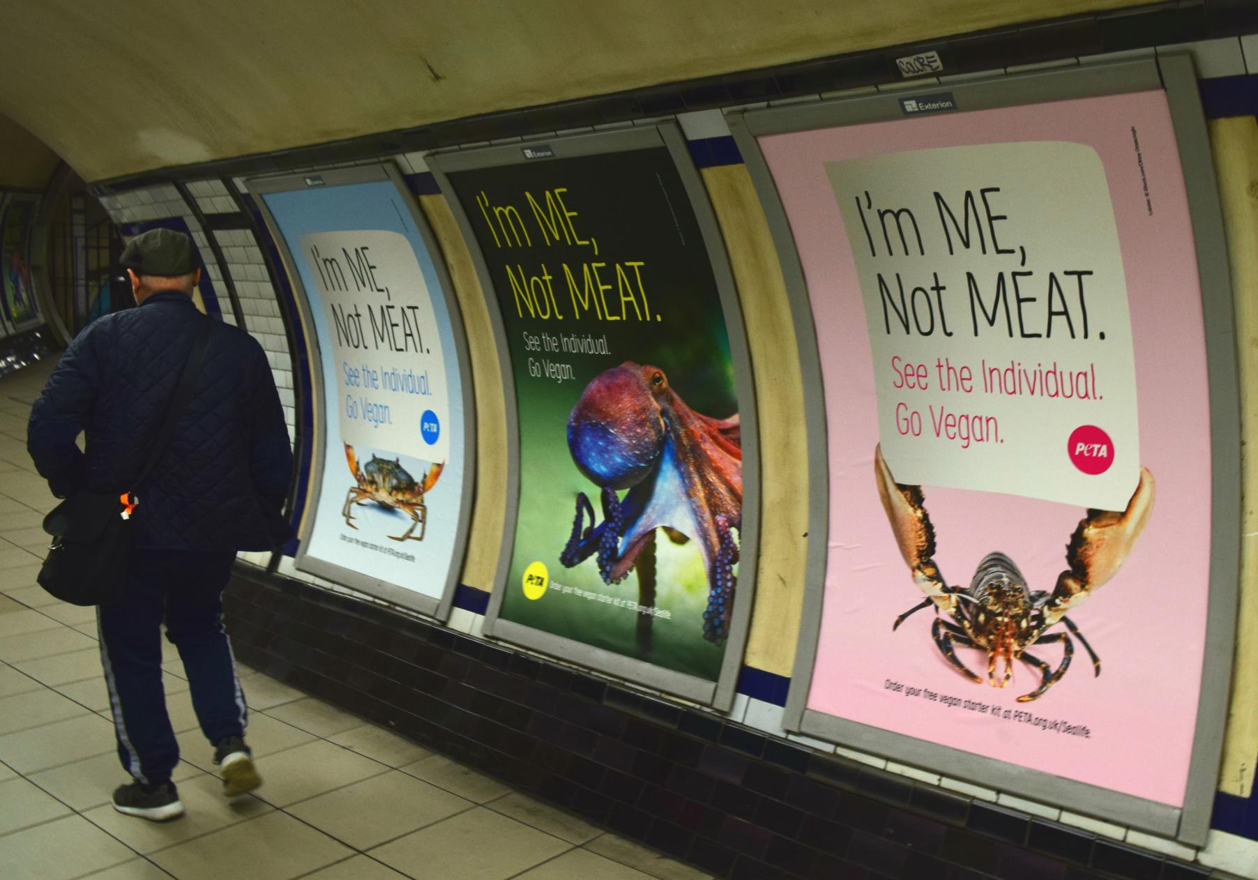 Vegan posters by PETA at Clapham Common tube station