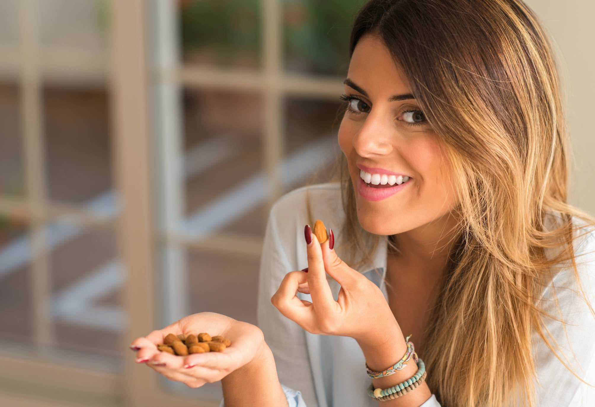A woman eating nuts