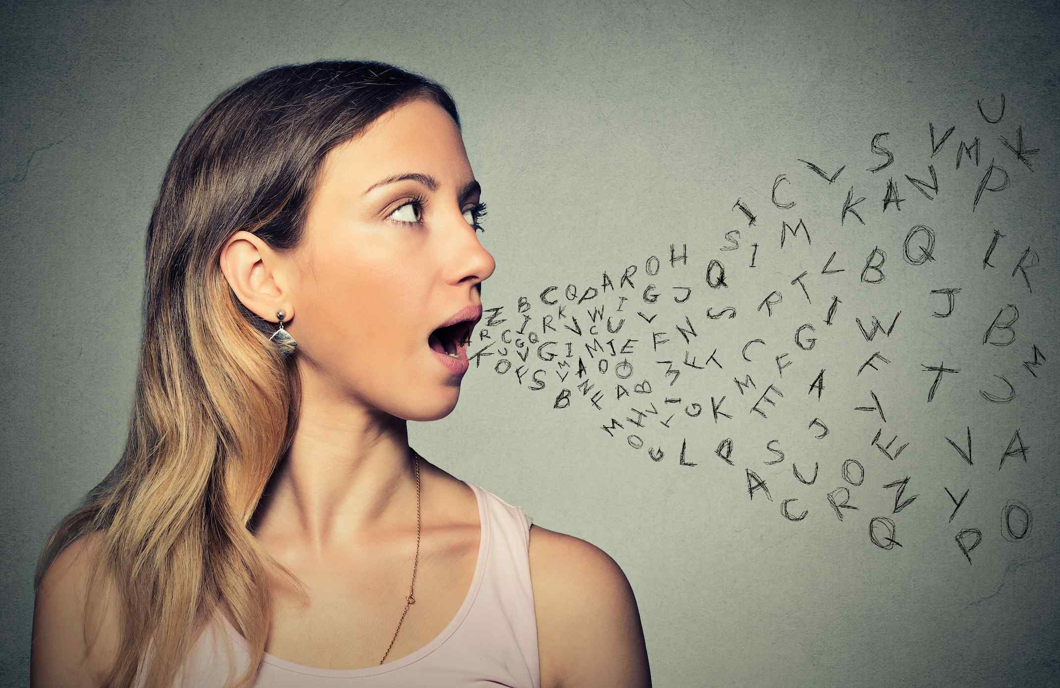 Woman with letters coming out of her mouth