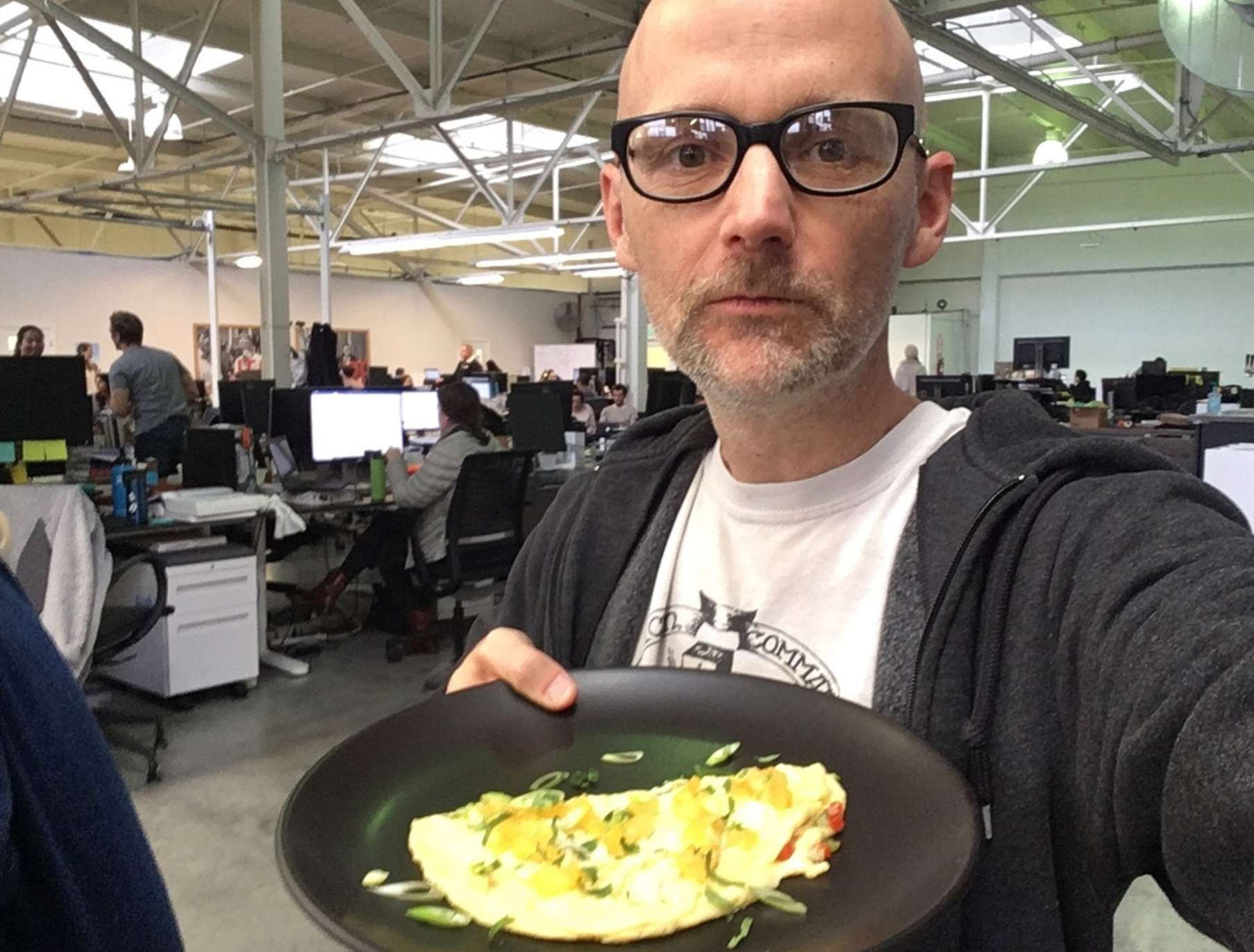 Vegan celebrity Moby holding a plate of vegan JUST Egg