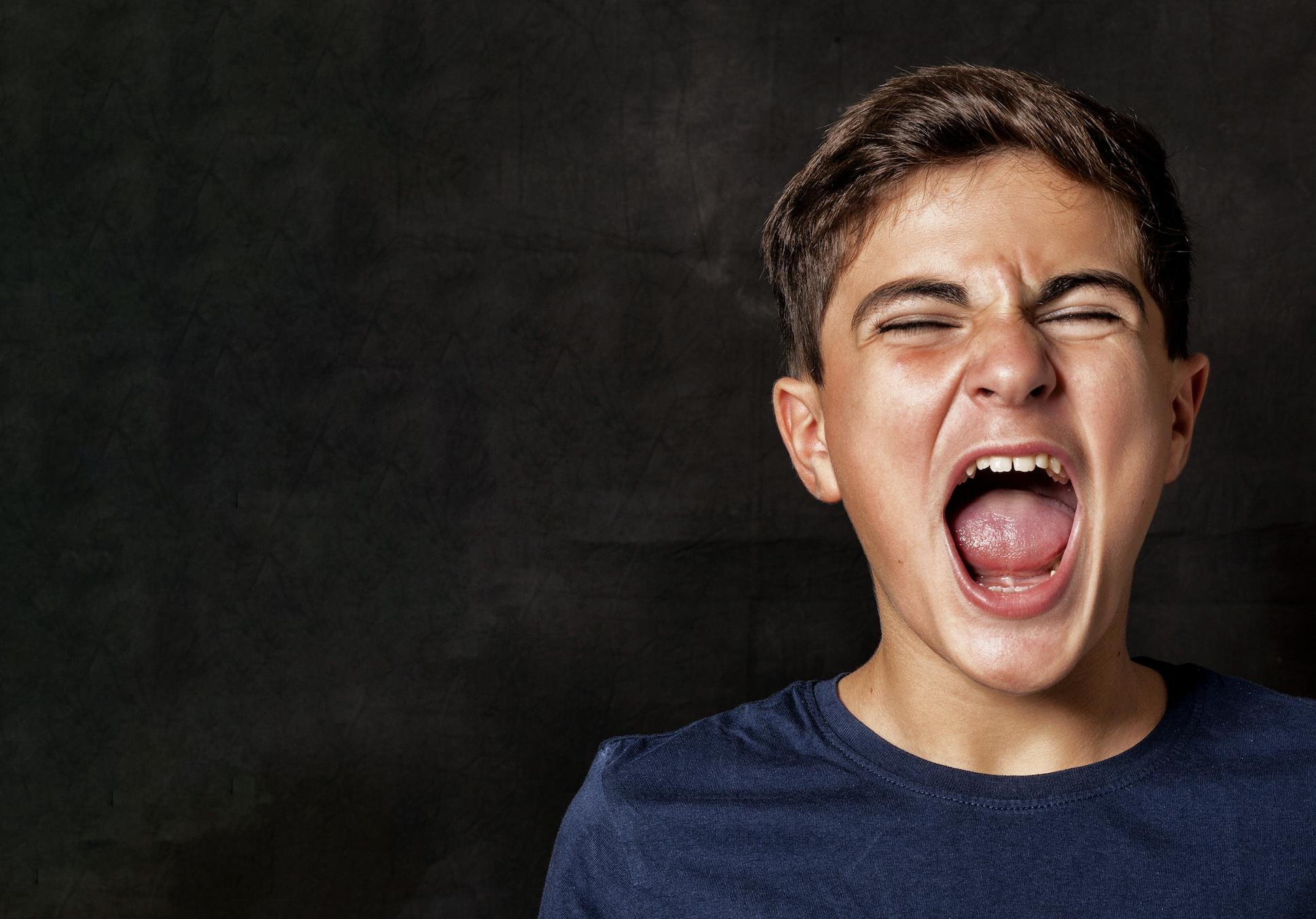 A young man screaming