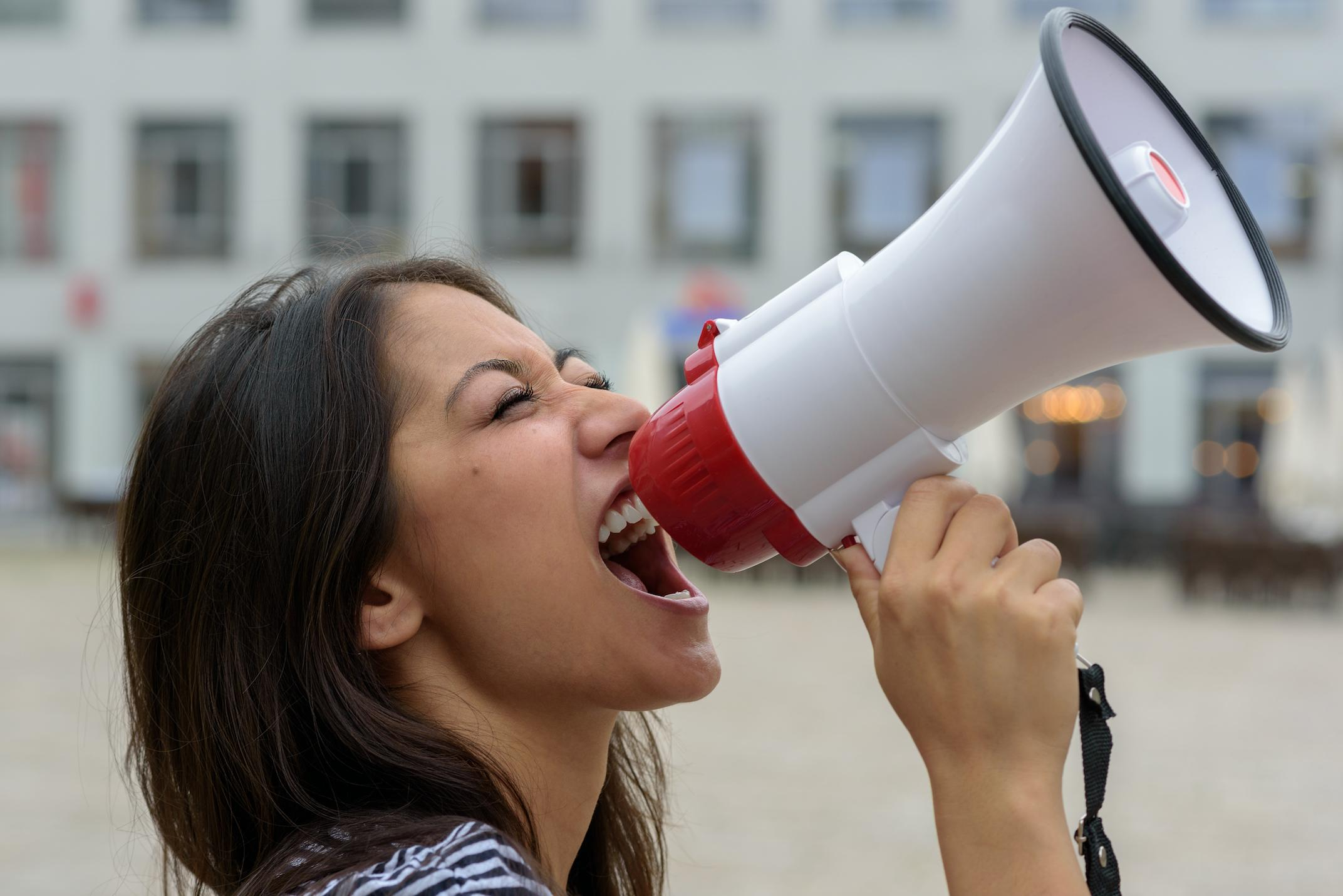 Woman shouts through megaphone