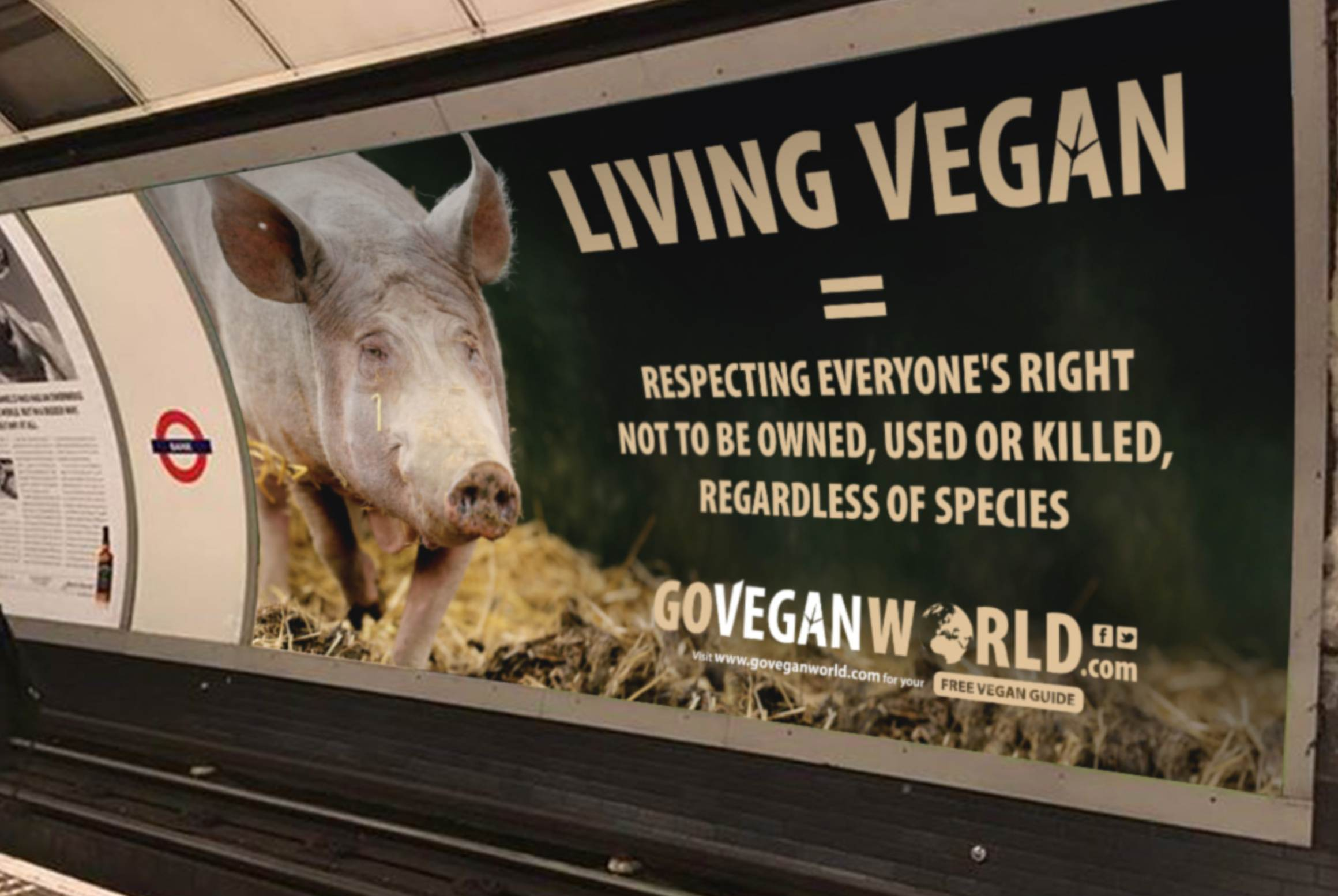 Giant Go Vegan World poster on the tube