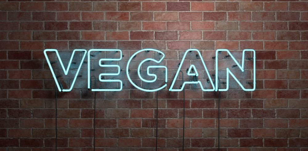 Vegan neon sign on a brick wall