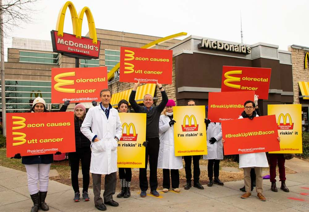 Dr. Neal Barnard demonstrates outside McDonald's
