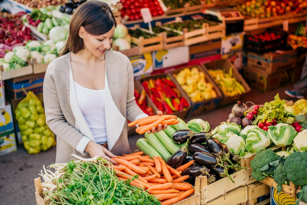 Woman buying vegetables from a market