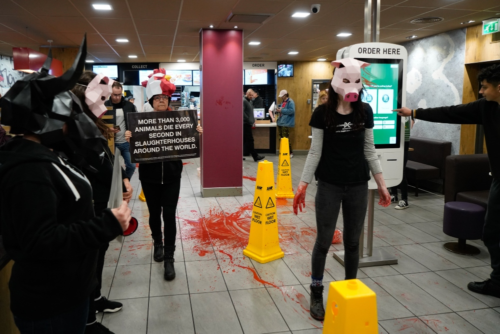 Vegan Activists Storm McDonald's And Cover It In Fake Blood
