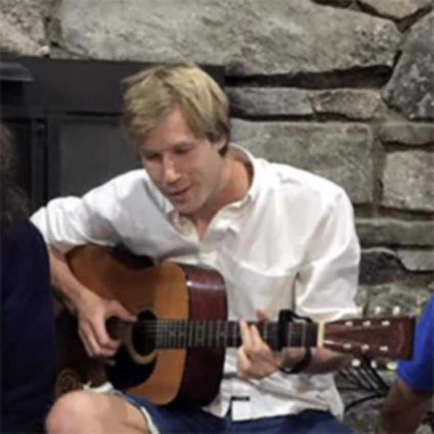 Graham Whitley - playing guitar