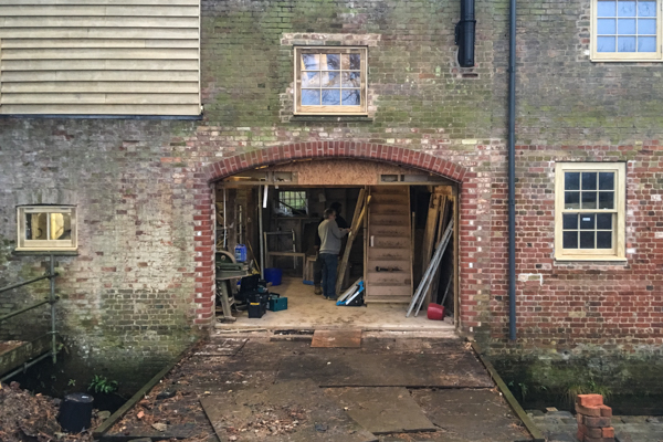 Temporary boarding removed from the archway ready to install the doors