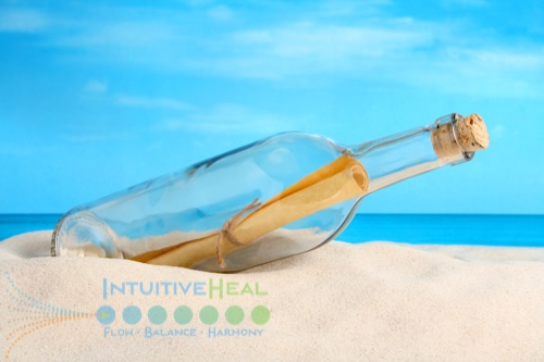 Photo of message in a bottle on a beach