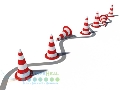 Image of wavy line meandering through red/white traffic cones