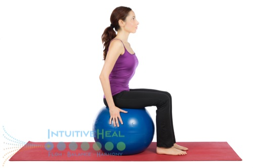 Photo of woman sitting on an exercise ball