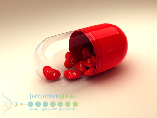 Photo of oversized pill capsule with red hearts in it