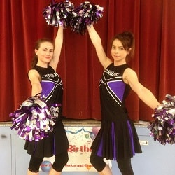 Two cheerleader entertainers posing