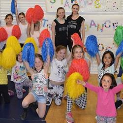 Kids at a cheerleading workshop cheering