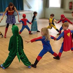 Children dressed as superheros at a party in Cambridge
