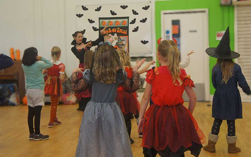 Kids dancing at a Halloween workshop