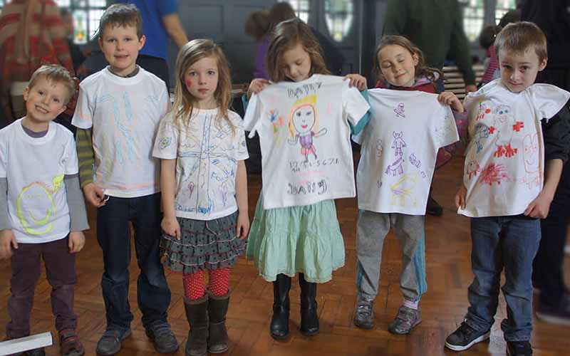 Kids showing off their t-shirt crafts