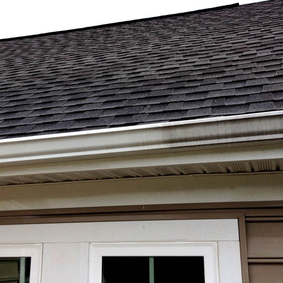A gutter before being cleaned in Butler PA