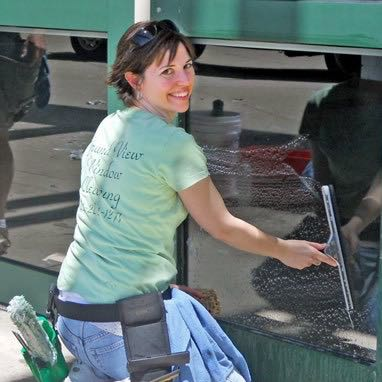 Cathy cleaning a storefront window