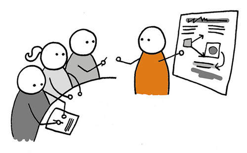 orange stickman cartoon pitching a user experience strategy to a team