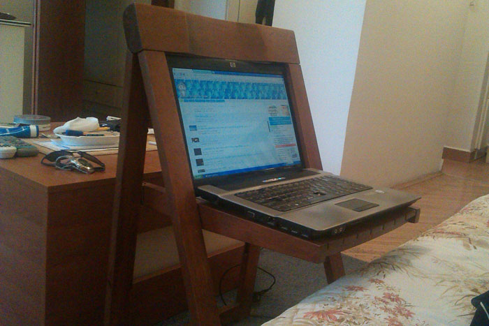 A computer sitting inside of a chair