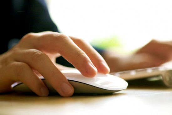 a user clicking on a computer mouse