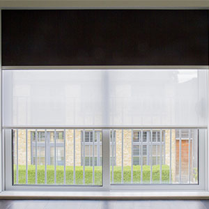 Double roller blinds in bi-folding doors