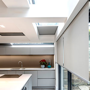 Hidden electric blinds in London kitchen extension