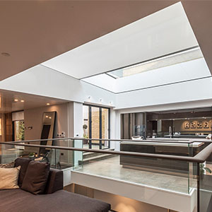 Concealed skylight blind in atrium