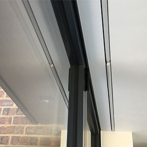 Hidden roller blinds in bi-folding doors