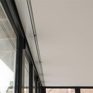 Hidden roller blinds in folding doors