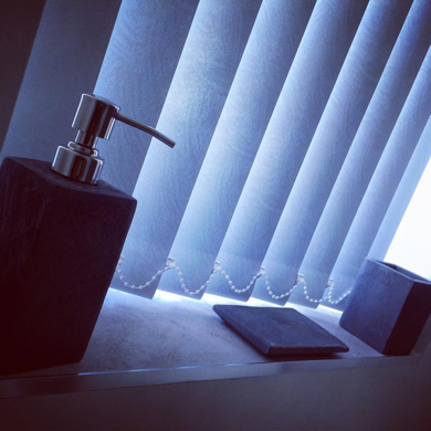 white vertical blinds in bathroom