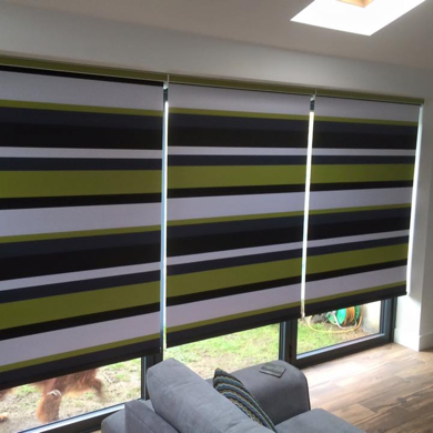 striped green roller blinds fitted on patio doors